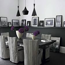 modern dining areas with black table and black white striped chairs purple flower on table with black pendant lamp dweefcom interior decorating black and white striped furniture