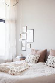 feminine bedroom furniture bed: interior design inspiration a neutral yet feminine bedroom with art collection and cozy comfort detailing