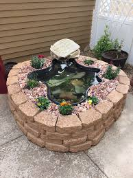 diy patio pond: above ground pond using garden wall blocks patio pond fish summer