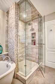 spa bathroom showers: monarch kitchen and bath centre glass shower mosaic tile frame less shower