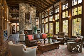 living room carolina design associates: living room toward fireplace and windows looking out to fall color balsam nc