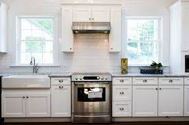 glass door panels cabinets cabinet  renovated kitchen with white subway tile marble and farmhouse sink co
