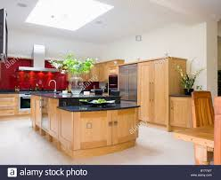 kitchen worktop granite pale wood island unit with black granite worktop in large modern kitch