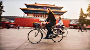 bbc capital how does your expat package stack up living abroad can broaden your horizons two women cycle in beijing getty images