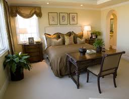 unlike many of these bedrooms this space has a desk set directly at the foot bed desk set