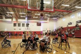 u s department of defense photo essay the u s army veteran and active duty wheelchair basketball team score a basket in a game