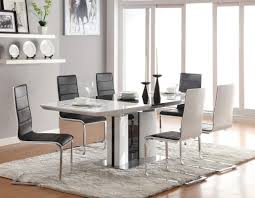 kitchen pedestal dining table set: dining room design ideas using furry white rug under dining table including black white