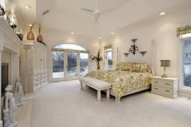 big master bedrooms couch bedroom fireplace: shutterstock  the focal point of this bedroom is the large fireplace