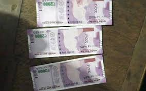 Rs. 2000 notes sans Mahatma image land in farmer's hands - The ...
