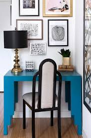 add one strong pop of color like this teal desk to brighten chic mint teal office