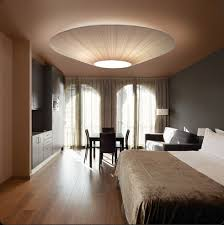 bovers siam makes a statement in this bedroom while providing a functional ambient light bedroom ambient lighting