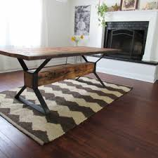 modern wood dining room sets: industrial trestle reclaimed wood dining table by peter gadjev