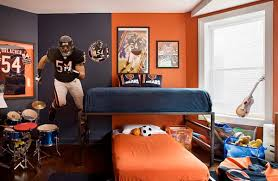themed kids room designs cool yellow: view in gallery sports themed kids bedroom in blue and orange