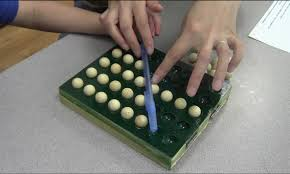 carnegie mellon building educational software to teach children researchers use a repurposed bingo tray to kid test a mathematical concept at carnegie mellon s children s school before incorporating it into an