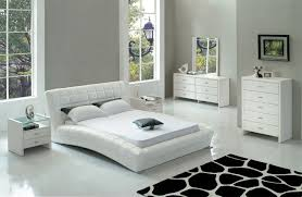 charming reclining queen bed in white color applying tufted design completed with twin nightstands of modern bedroom furniture
