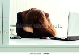 young tired businesswoman sleeping at her workplace in office stock image business nap office relieve