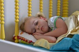 Image result for sleeping child, hands tucked under head