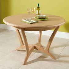 cream compact extending dining table: vale furnishers carlson round extending dining table