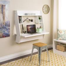 living room desks furniture: prepac studio floating desk in white with yellow pattern rug
