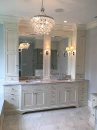cabinet marble bathroom large ivory master bathroom features a robert abbey bling chandelier illumin