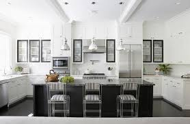 st charles kitchen cabinets: a trio of jamie young st charles pendants mercury glass pendants hangs over a black kitchen island topped with black marble lined with gray striped