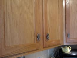 gel stain kitchen cabinets: cozy wooden kitchen cabinet using general finishes java gel stain with metal handle and tile backsplash