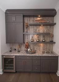 contemporary bar with shaker style cabinets built in bookshelf hardwood floors built basement lighting ideas