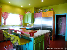 this holiday home is not only painted with much colors but also it is furnished in colorful furniture design bright painted furniture
