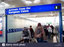customs and excise stock photos customs and excise stock images passengers passing through the arrivals from the european union customs channel at stansted airport england