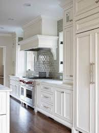 beautiful white kitchen cabinets: love this kitchen white kitchen  of  like hardwood floor color white paneled hood with swing arm pot filler wolf stove cabinets installed over