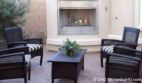 black wicker patio furniture surrounds the cozy fireplace black outdoor furniture