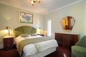 beach bedroom nuance with art deco green furniture also wooden storage plus dim lighting art deco era furniture