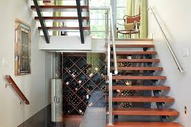 view in gallery awesome contemporary wine cellar under the sleek staircase from wakefield construction first impressions box version modern wine cellar