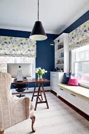 dark blue seats home office transitional with dark blue walls built in bookshelves blue home office dark wood