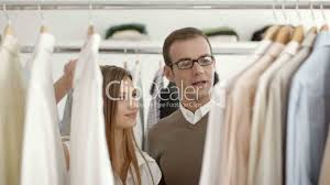 man talking s assistant in clothes shop royalty s assistant · s clerk · s manager · sclerk · seller · selling · shirt · shop