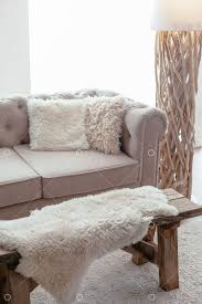 Still life details of <b>nordic living room</b>. Sheep skin rug on rustic bench ...