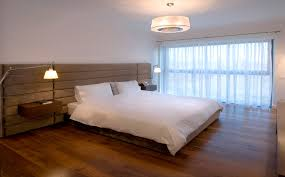 bedroom trendy bedroom photo in other with medium tone hardwood floors ceiling lighting for bedroom