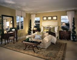big master bedrooms couch bedroom fireplace: this bedroom uses space well by creating a small sitting area at the end of the
