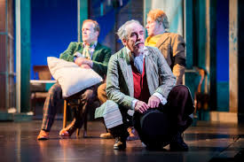 twelfth night great lakes theater feste actor m a taylor center waxes poetic as sir andrew aguecheek actor tom ford left and sir toby belch actor aled davies right observe in