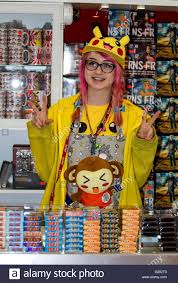 young s assistant working at the tokyotoys manga and anime stock photo young s assistant working at the tokyotoys manga and anime retail store in glasgow uk