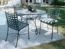 image of enthralling black wrought iron patio furniture of frosted glass top dining table and vintage black wrought iron patio