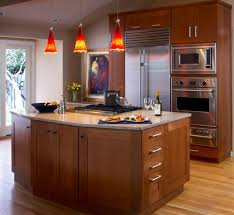 bright red pendant lights offer a vivid contrast to this largely neutral kitchen astounding kitchen pendant