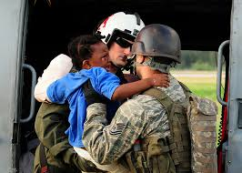u s department of defense photo essay u s navy petty officer 2nd class jason harold transfers a young an earthquake victim from an