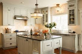 lighting over kitchen farmhouse with french double doors cookbook shelves lighting over kitchen traditional with beaded board better homes gardens better homes and gardens lighting