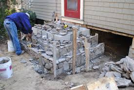 stone patio installation: wood deck removal stone patio and stairs installation