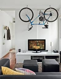 storage solutions living room:  bike living room storage design