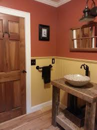 country themed reclaimed wood bathroom storage: cool country bathroom design for small space with vintage trunk sink vanity and beige wainscoting