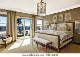 luxury bedroom interior with rich furniture and scenic view from walkout deck bedroom interior furniture