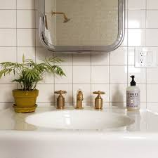 dwell bathroom ideas spacious modern bathroom  cool modern bathroom furniture with rounded deep wash basin unify sleek ceramic vanity units also sterling brass furnishing faucet including fresh plant pot under slick mirrors organizer stainless fra