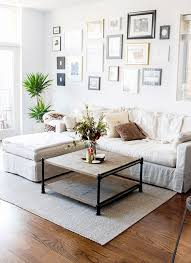 chic and casual living room with gallery wall and lots of plants casual living room lots
